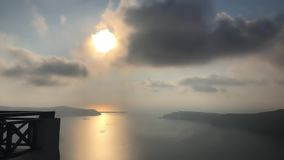 Santorini Island In The Evening. This stock footage features a beautiful view of the Greek Island of Santorini in the evening. This clip shows the setting sun