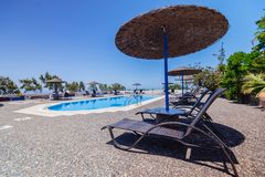 Santorini Island. Greece. Caldera. Red beach. Fira. Oia. swimming pool, hotel Royalty Free Stock Photography