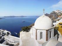 Santorini island, Greece. Hotel terrace, church  and sea view. Travel, Vacation and Hospitality - Santorini island Stock Photo