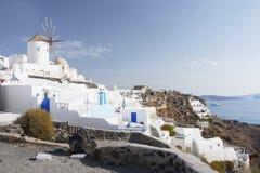 Santorini island, Greece. Hotel terraces, old windmill  and sea view. Travel, Vacation and Hospitality - Santorini island Stock Photo