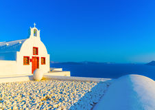 In Santorini island in Greece. Old small white church in Oia the most beautiful village of Santorini island in Greece Royalty Free Stock Image