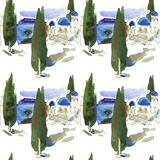 Santorini island in the Greece. Stylized small white houses with blue domed roofs and small windows and sea on the background. royalty free stock images