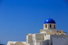 Santorini island in Greece - White church on blue background. Santorini island in Greece - White church on blue sky background Royalty Free Stock Photos