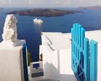 Santorini Island Landscape Greece Travel. Apartments entrance gate with lion statue and sea view. Santorini island, Greece Stock Image