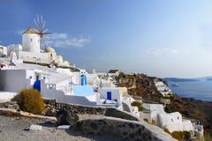 Santorini Island Landscape Greece Travel. Old windmill and  Oia village, Santorini island, Greece Stock Images