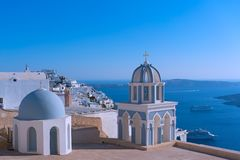 Santorini Island landscape with view on town and Aegean Sea. Church on a cliff overlooking Aegean Sea, Santorini Island, Greece royalty free stock photo