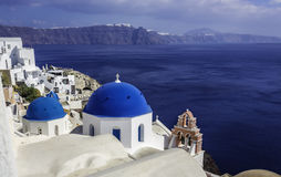 Santorini Island scene with  blue dome churches Royalty Free Stock Photography