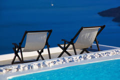 Santorini island with sunbeds in Greece Royalty Free Stock Images