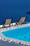 Santorini island with sunbeds in Greece Royalty Free Stock Image