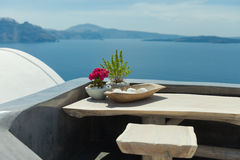 Santorini. Island view with flower composition. Stock Photography