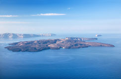 Santorini - islands Nea Kameni and Palea Kameni and the south part of the Island in background. Royalty Free Stock Photography