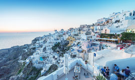 SANTORINI - JULY 11, 2014: People wait for sunset time in Oia to Stock Images