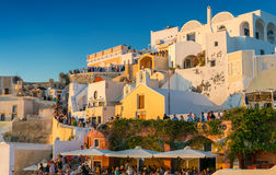 SANTORINI - JULY 11, 2014: People wait for sunset time in Oia to Royalty Free Stock Images