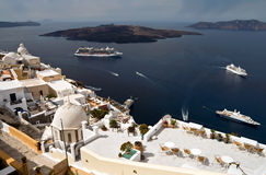 Santorini landscape. Bay of Santorini with small island and some vessels Royalty Free Stock Image