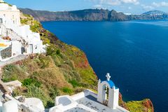 Santorini landscape in Oia with view of caldera and Aegean Sea. View of volcano caldera and Aegean Sea in Oia, Santorini, Greece royalty free stock photography