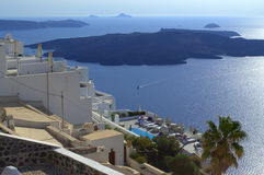 Santorini villas and volcano Nea Kameni Stock Photos