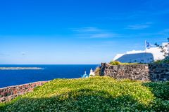 Santorini landscape with wild flowers and Aegean Sea in Oia stock image