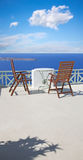 Santorini - The little table and easy charis over the caldera Royalty Free Stock Photos