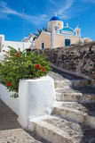 Santorini - The little typically white-blue church in Oia. Stock Photography