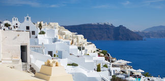 Santorini - The look from Oia over luxury resorts to east with the Skaros castle Royalty Free Stock Photo