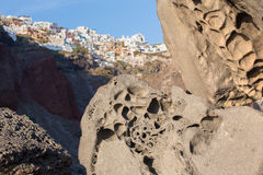 Santorini - look to Oia across the pumice boulders. Stock Photography