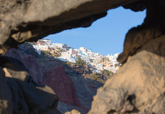Santorini - look to Oia across the pumice boulders. Royalty Free Stock Image