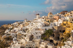 Santorini - The look to part of Oia with the windmills in evening light. Royalty Free Stock Photography