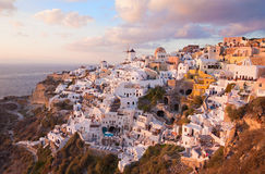 Santorini - The look to part of Oia with the windmills in evening light. Stock Photo