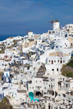 Santorini - The look to part of Oia with the windmills. Stock Photo