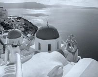 Santorini - The look to typically blue church cupolas in Oia. Over the caldera Stock Photography