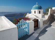 Santorini - The look to typically church cupolas in Imerovigli over the caldera. In background Royalty Free Stock Photos