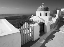 Santorini - The look to typically church cupolas in Imerovigli over the caldera in background.  Royalty Free Stock Photography