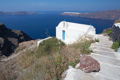 Santorini - look to typiycally little church Agios Ioannis Katiforis in Imerovigli near the Skaros. Royalty Free Stock Photo
