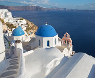 Santorini - The look to typycally blue church cupolas in Oia. Over the caldera Royalty Free Stock Photography