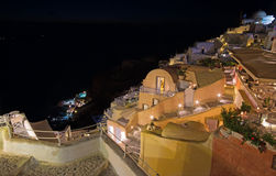 Santorini - look from town down to harbor Amoudi in Oia. Stock Image