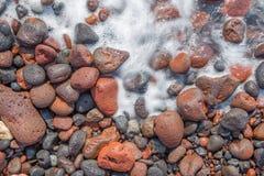 Santorini - o detalhe de pemza da praia vermelha Imagens de Stock Royalty Free