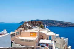 SANTORINI,OIA-JULY 28: Group of tourists on the top of Oia castle on July 28,2014 in Oia town on the Santorini island, Greece. Royalty Free Stock Photos