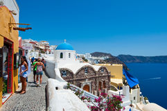 SANTORINI,OIA-JULY 28: Tourists go shopping on July 28,2014 in Oia town on the Santorini island, Greece. Stock Images