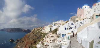 Santorini - Oia and the Therasia island in the background. Stock Images