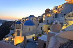 Santorini, Oia village over Aegean sea at sundown Royalty Free Stock Photos