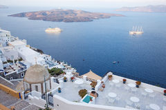 Santorini - The outlook from Fira to caldera with the Nea Kameni Island in morning. Light Royalty Free Stock Image