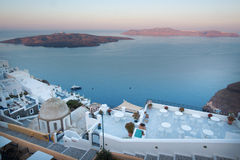 Santorini - The outlook from  Fira to caldera with the Nea Kameni Island in morning light. Royalty Free Stock Images