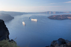 Santorini - The outlook over the Imerovigili to caldera with the cruises and Nea Kameni Island in morning Royalty Free Stock Image