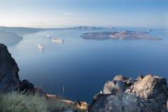 Santorini - The outlook over the Imerovigili to caldera with the cruises and Nea Kameni Island Stock Photos