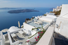 Santorini - outlook over the luxury resort in Imerovigili to caldera with the cruises. Royalty Free Stock Photography