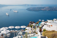 Santorini - The outlook over the luxury resort in Imerovigili to caldera with the cruises and Na Kameni Royalty Free Stock Photography