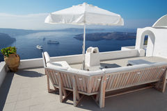 Santorini - outlook over the luxury resort in Imerovigili to caldera with the cruises and Nea Kameni island. Stock Photos