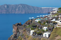 Santorini - The outlook over the luxury resort in Imerovigili to caldera with the Therasia island Royalty Free Stock Photography