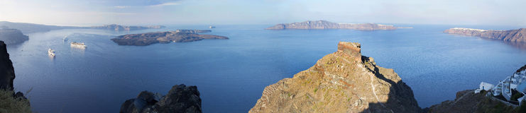 Santorini - The outlook over the Scaros castlet in Imerovigili to caldera with the cruises in morning Royalty Free Stock Photo