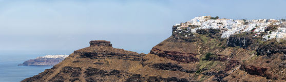 Santorini Panorama. A panoramic image from Santorini of the villages of imerovigli and Oia with the rock of skaros in between them Royalty Free Stock Photo